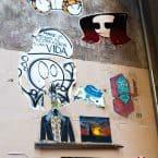 Various Barcelona street art on a wall